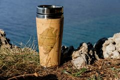 Traveler thermos mug with tea over sea view.  Royalty Free Stock Images