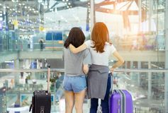 Traveler together in airport concept. Young asian backpack with carrying hold luggage and passenger for tour travel booking ticket flight international royalty free stock images