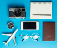 Traveler tools and documents flatlay on blue. Surface Stock Photos