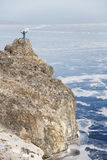 Traveler on top of the island Oltrek. Lake Baikal. Winter landsc Royalty Free Stock Photos