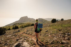 Traveler on top of mountains. stylish women hiking. atmospheric moment Stock Image