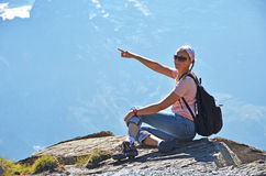 Traveler on the top of a rock Stock Image