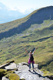 Traveler on the top of a rock Stock Photos