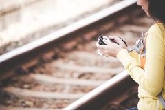 Traveler and tourist asian young women wearing backpack holding map and camera, waiting for a train. Traveler and tourist asian young woman wearing backpack Stock Photos