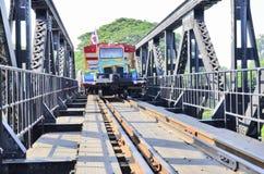 Traveler train on iron bridge Stock Photo