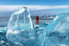 Traveler among transparent Baikal ice Stock Images