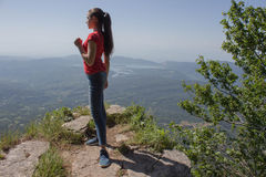 Traveler travel In the mountains reserve. Eco tourism and healthy lifestyle concept. Young hiker girl with backpack Stock Image