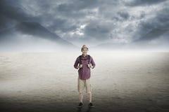 Traveler trekking in the desert Royalty Free Stock Images
