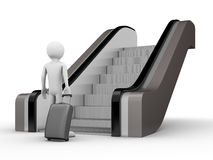 Traveler with a trunk before escalator. Traveler with a trunk standing before escalator Royalty Free Stock Images