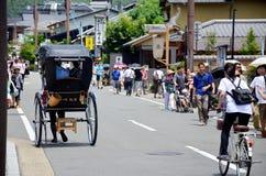 Traveler use rickshaw for tour around arashiyama city Stock Photos