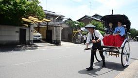 Traveler use rickshaw for tour around arashiyama city stock video