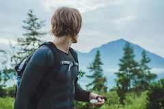 Traveler using a compass to get Batur volcano and Agung mountain Stock Photo