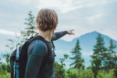Traveler using a compass to get Batur volcano and Agung mountain Royalty Free Stock Photography