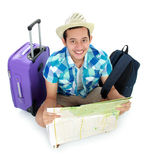 Traveler using map. Male tourist looking at the map while seating isolated on white background Stock Photo