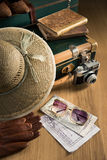 Traveler with vintage camera and maps Royalty Free Stock Photography