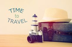 Traveler vintage luggage, camera and fedora hat over wooden table. holiday and vacation concept. Traveler vintage luggage, camera and fedora hat over wooden Stock Image