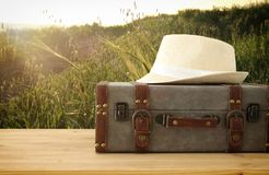 Traveler vintage luggage and fedora hat over wooden table. holiday and vacation concept. Traveler vintage luggage and fedora hat over wooden table. holiday and Royalty Free Stock Photos
