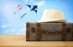 Traveler vintage luggage and fedora hat over wooden table. holiday and vacation concept. Traveler vintage luggage and fedora hat over wooden table. holiday and Royalty Free Stock Photo