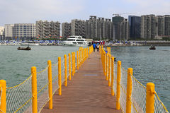 Traveler visiting on the pontoon. China ( xiamen city ) international boat show 2014 was held in music island of wuyuanwan marina on 7th to 10th, november Stock Photos
