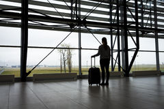 Traveler waiting at airport terminal Royalty Free Stock Images