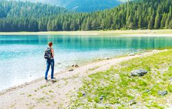 Traveler is walking on the lake coast Royalty Free Stock Image