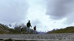 Traveler Walking On The Road In The Mountains Near Khunjerab Pass, Pakistan China Border