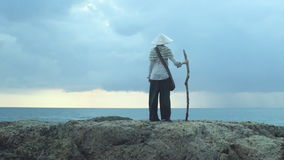 Traveler With Walking Stick On The Sea Rock stock video footage