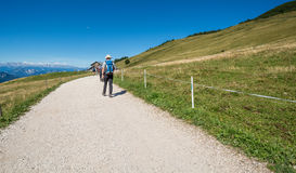 Traveler walking on a trail in Dolomites Mountains, South Tyrolo, Italy Royalty Free Stock Photography