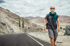 Traveler walks on the mountain road in indian Himalaya Royalty Free Stock Images