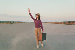 Traveler waves her hand Royalty Free Stock Photography