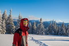Traveler wearing a jacket with a hood in winter Royalty Free Stock Photography