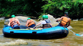 The traveler whitewater with Inflatable Boat at Chiang Mai, Thai Royalty Free Stock Photo