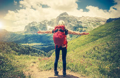 Traveler Woman with backpack hands raised mountaineering Stock Photos