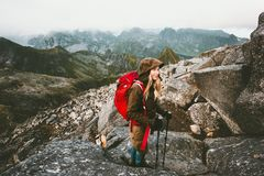Traveler woman with backpack. On Hermannsdalstinden mountain summit in Norway Travel Lifestyle wanderlust concept adventure active vacations outdoor hiking Royalty Free Stock Photos