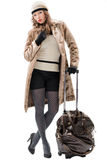 Traveler woman with a bag. On white background. Spring/Autumn/winte r Royalty Free Stock Photo