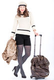 Traveler woman with a bag. On white background. Spring/Autumn/winte r Stock Photography