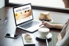 Traveler woman choosing a hotel online Stock Photography