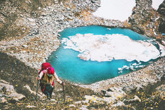 Traveler woman climbing to mountains summit. Blue lake aerial view Travel Lifestyle adventure concept summer vacations outdoor Royalty Free Stock Image