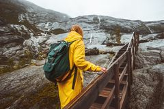 Traveler woman climbing up stairs in rocky mountains Stock Photography