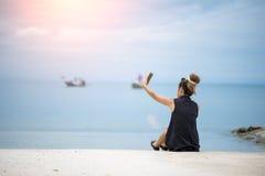 Traveler woman doing selfie on beach summer stock images