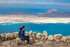 Traveler woman enjoying beautiful seascape at viewpoint royalty free stock images