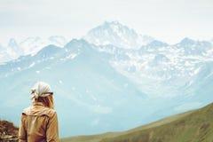 Traveler Woman enjoying Caucasus Mountains range. Landscape Travel Lifestyle concept Summer trip vacations outdoor Stock Photos