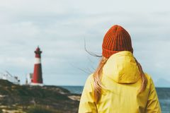 Traveler Woman enjoying Norway lighthouse sea landscape Travel Lifestyle solitude concept scandinavian vacations outdoor. Melancholy emotions Royalty Free Stock Photo