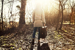 Traveler woman follows the light of hope in the forest Royalty Free Stock Photo