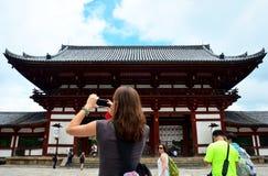 Traveler woman foreigner use smart phone shooting photo Todai-ji. Temple on July 9, 2015 in Nara, Japan Stock Photo