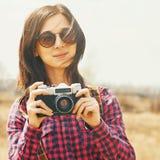 Traveler woman holding vintage photo camera Royalty Free Stock Photography