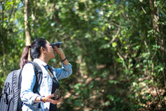 Traveler woman look binoculars on the forest,. Background forest Thailand, select and soft focus Royalty Free Stock Photos