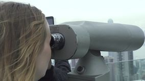 Traveler woman looking city panorama by tourist binoculars on Victoria Peak Hong Kong China. Tourist woman looking. Telescope binoculars on observation deck stock footage
