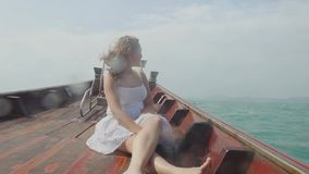 Young woman looking destination island and relaxing on wooden boat. Travel in Thailand, Summer holiday and outdoor. Traveler woman looking destination island and stock footage