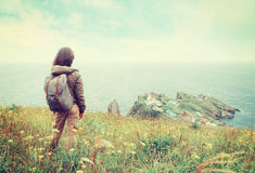 Traveler woman looking to the town on peninsula Stock Images